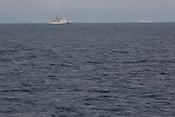 A Japanese coast guard ship sails close to the Greenpeace ship Rainbow Warrior, on the eastern coast of Japan, near to Fukushima, in Japan, Tuesday 3rd May 2011.