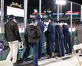 Some of the Trinity Bantams watch the first game before being chased from the glass by Fenway staff. - The Williams College Ephs defeated the Trinity College Bantams 4-2 (EN) on Tuesday, January 7, 2014, at Fenway Park in Boston, Massachusetts.