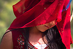 Girl with a red veil attending a prayer meeting at the temple of Dakshinkali (Nepal, 2011).<br />