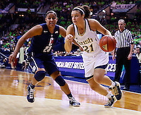 SOUTH BEND, IN - MARCH 04: Kayla McBride #21 of the Notre Dame Fighting Irish dribbles the ball around Kaleena Mosqueda-Lewis #23 of the Connecticut Huskies at Purcel Pavilion on March 4, 2013 in South Bend, Indiana. Notre Dame defeated Connecticut 96-87 in triple overtime to win the Big East regular season title. (Photo by Michael Hickey/Getty Images) *** Local Caption *** Kayla McBride; Kaleena Mosqueda-Lewis