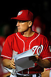 22 August 2009: Washington Nationals' batting coach Rick Eckstein reviews notes in the dugout during a game against the Milwaukee Brewers at Nationals Park in Washington, DC. The Nationals fell to the Brewers 11-9 in the second game of their four-game series. Mandatory Credit: Ed Wolfstein Photo