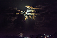 Tugun, Queensland Australia. (Thursday March 20, 2014) –  The moon rising over Tugun and Coolangatta on the night of the 20th of March, the Equinox, with a plane crossing the moon on it's descent into Coolangatta airport.  Photo: joliphotos.com