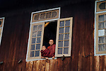 _DSC0108, Burma/Myanmar, 2008, BURMA-10524. Two young monks look out the window.
