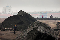 Coal in piles by Yangzi River, Yichang, China