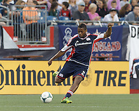 New England Revolution defender Andrew Farrell (2) passes the ball.  In a Major League Soccer (MLS) match, the New England Revolution (blue) tied D.C. United (white), 0-0, at Gillette Stadium on June 8, 2013.