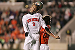New Mexico's Lars Loeseth heads the ball over Clemson's Bradley Gibson (r). The University of New Mexico Lobos defeated the Clemson University Tigers 2-1 in a Men's College Cup Semifinal at SAS Stadium in Cary, NC, Friday, December 9, 2005.
