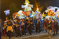 """Local residents joined by Columbia University students and faculty carry lanterns in the 5th annual Morningside Lights procession on Saturday, September 24, 2016. Produced by Columbia University Arts Initiative and Miller Theatre, the paper-mâché illuminated lanterns  fulfilled the theme of this years' procession; """"Traverse: 100 Years of Pulitzer Poetry"""". The parade woound its way through Morningside Park eventually ending at the Columbia campus.  (© Richard B. Levine)"""