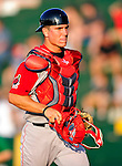 18 June 2010: Lowell Spinners catcher Carson Blair returns to the dugout during a game against the Vermont Lake Monsters at Centennial Field in Burlington, Vermont. The Lake Monsters defeated the Spinners 9-4 in the NY Penn League season home opener. Mandatory Credit: Ed Wolfstein Photo
