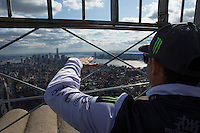 New York, USA. 23 April 2014.  Supercross motorcycle racer Chad Reed   watch middle and lower Manhattan as he promotes his motorcycle race during a visit to the Empire State Building in New York. Photo by Eduardo Munoz Alvarez/VIEWpress