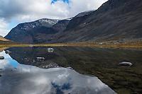 Mountain reflection in small lake along Dag Hammarskjöldsleden, Lappland, Sweden