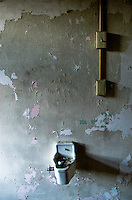 Hallway fountain in abandoned catholic schoolhouse in Vicksburg Mississippi