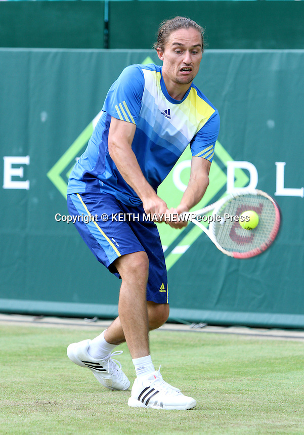 Alexandr Dolgopolov (Ukraine) plays Sam Querrey (USA) at The Boodles Tennis Challenge held at Stoke Park, Buckinghamshire, UK - June 21st 2013<br /> <br /> Photo by Keith Mayhew
