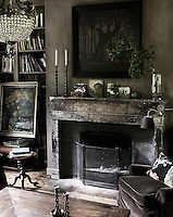 The living room has been decorated in a distressed fashion, a style which is reflected throughout the house, creating what Beatrix Kleuver describes as 'country chic'