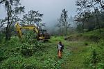 November 20, 2014.<br /> Una mujer maya camina al lado de una maquina abandonada por la empresa espa&ntilde;ola Ecoener, en Santa Cruz de Barillas (Guatemala).<br />   La llegada de algunas compa&ntilde;&iacute;as extranjeras a Am&eacute;rica Latina ha provocado abusos a los derechos de las poblaciones ind&iacute;genas y represi&oacute;n a su defensa del medio ambiente. En Santa Cruz de Barillas, Guatemala, el proyecto de la hidroel&eacute;ctrica espa&ntilde;ola Ecoener ha desatado cr&iacute;menes, violentos disturbios, la declaraci&oacute;n del estado de sitio por parte del ej&eacute;rcito y la encarcelaci&oacute;n de una decena de activistas contrarios a los planes de la empresa. Un grupo de ind&iacute;genas mayas, en su mayor&iacute;a mujeres, mantiene cortado un camino y ha instalado un campamento de resistencia para que las m&aacute;quinas de la empresa no puedan entrar a trabajar. La persecuci&oacute;n ha provocado adem&aacute;s que algunos ecologistas, con &oacute;rdenes de busca y captura, hayan tenido que esconderse durante meses en la selva guatemalteca.<br /> <br /> En Cob&aacute;n, tambi&eacute;n en Guatemala, la hidroel&eacute;ctrica Renace se ha instalado con amenazas a la poblaci&oacute;n y falsas promesas de desarrollo para la zona. Como en Santa Cruz de Barillas, el proyecto ha dividido y provocado enfrentamientos entre la poblaci&oacute;n. La empresa ha cortado el acceso al r&iacute;o para miles de personas y no ha respetado la estrecha relaci&oacute;n de los ind&iacute;genas mayas con la naturaleza. &copy; Calamar2/Pedro ARMESTRE<br /> <br /> The arrival of some foreign companies to Latin America has provoked abuses of the rights of indigenous peoples and repression of their defense of the environment. In Santa Cruz de Barillas, Guatemala, the project of the Spanish hydroelectric Ecoener has caused murders, violent riots, the declaration of a state of siege by the army and the imprisonment of a dozen activists opposed to the project . <br /> A gro
