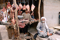 Afghan butcher next to a Afghan refugee camp in Peshawar, Pakistan