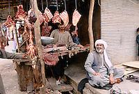 Afghan butcher next to a Afghan refugee camp in Peshawar, Pakistan