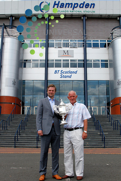 Celtic & Scotland Legend Bobby Lennon along side Falkirk Manager Steven Pressley display the Scottish Cup as it breaks two World Records..Glasgow, 4th JULY, 2011..Picture:Stuart Campbell Universal News And Sport (Europe)