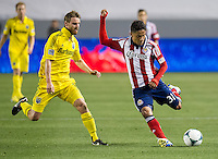 CARSON, CA - March 2, 2013: Columbus midfielder Eddie Gaven (12) and Chivas midfielder Marvin Iraheta (31) during the Chivas USA vs Columbus Crew match at the Home Depot Center in Carson, California. Final score, Chivas USA 0, Columbus Crew 3.