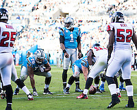 The Carolina Panthers defeated the Atlanta Falcons 34-10 in an inter-division rivalry played in Charlotte, NC at Bank of America Stadium.  Carolina Panthers quarterback Cam Newton (1) calls a play.