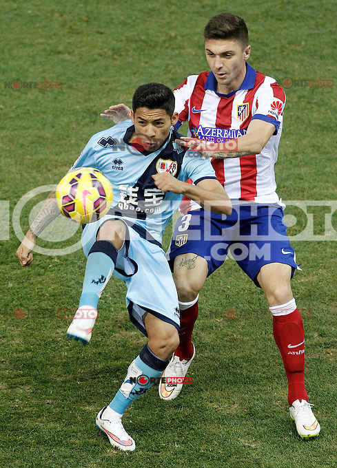 Atletico de Madrid's Jose Maria Gimenez (r) and Rayo Vallecano's Javier Ignacio Aquino during La Liga match.January 24,2015. (ALTERPHOTOS/Acero) /NortePhoto<br />