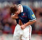 Ally McCoist scores the opener in a league match against Dunfermline and responds to the Pars fans who were labelling him a fat sumo striker by showing his physique to Brian Laudrup
