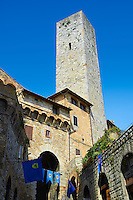 The 13th century medieval walls entrance gate and tower of San Gimignano. Originally San Gimignano had  70 towers built for protection as a result of feuding families who supported the opposing Guelphs and Ghibellines. Today 12 survive in San Gimignano creating what is called the medieval Manhattan. A UNESCO World Heritage Sites. San Gimignano, Tuscany Italy