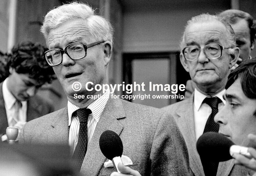 Douglas Hurd, newly appointed Secretary of State for N Ireland, photographed on the occasion of his first Press Conference on the steps of Stormont Castle, Belfast, N Ireland, 27th September 1984, 19840111DH8. Also in the photo (wearing glasses at RHS) is David Gilliland, director of information, N Ireland Office.<br />