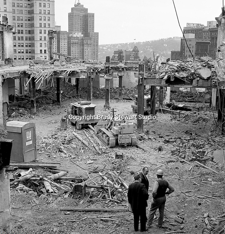 Pittsburgh PA:  View of the building demolition of one of downtown Pittsburgh's grand department stores, Rosenbaums. City inspectors checking on progress and safety at the building site.  Located at Penn Avenue and Sixth Street in Pittsburgh, the store closed in 1960 and taken down in 1963 to make way for the Sixth Avenue garage.  The demolition work was completed by D&H Building Wreckers.
