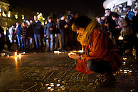 PARIS, FRANCE - NOVEMBER 15: People are gathering Place de la Republique and left some flowers, words and candles in memory of the victimes of the terrorist attacks in Paris, November 15,2015. The attacks of the 13th of November killed 129 people in Paris and injured 352 .