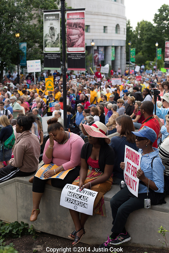 A crowd large crowd filled Bicentennial Plaza during the first Moral Monday of 2014 in Raleigh , N.C. on Monday, May 19, 2014. (Justin Cook)<br /> <br /> Since 2013 hundreds of people have gathered on Mondays when the North Carolina Legislature is in session to peacefully protest what they feel is a an extreme conservative agenda that endangers education, the poor, the unemployed, voting rights and organized labor in North Carolina. Many of the nonviolent protestors deliberately get arrested in acts of civil disobedience.