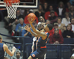 "Auburn guard Chris Denson (3) scores past Ole Miss' Reginald Buckner (23) at the C.M. ""Tad"" Smith Coliseum on Saturday, February 23, 2013."