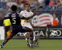 Monarcas Morelia defender Adrian Aldrete (16) passes the ball under pressure. The New England Revolution defeated Monarcas Morelia in SuperLiga 2010 group stage match, 1-0, at Gillette Stadium on July 20, 2010.