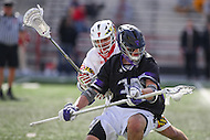 College Park, MD - February 18, 2017: High Point Panthers Nick Walsh avoids a Maryland Terrapins defender during game between High Point and Maryland at  Capital One Field at Maryland Stadium in College Park, MD.  (Photo by Elliott Brown/Media Images International)
