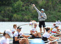 Hamilton, NEW ZEALAND.  Start, Pontoon Manager attracting attention.  2010 World Rowing Championships on Lake Karapiro, Tuesday - 02.11.2010, [Mandatory Credit Peter Spurrier:Intersport Images].