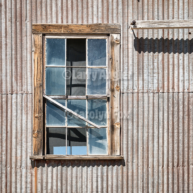 Window, corrugated wall, historic mining park, Tonopah, Nev.