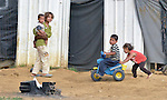 Children play in the Aamer al Sanad refugee settlement in Kab Elias, a town in Lebanon's Bekaa Valley which has filled with Syrian refugees. Lebanon hosts some 1.5 million refugees from Syria, yet allows no large camps to be established. So refugees have moved into poor neighborhoods or established small informal settlements, such as Aamer al Sanad, in border areas. International Orthodox Christian Charities, a member of the ACT Alliance, provides support for refugees in Kab Elias, including a community clinic.<br /> <br /> Parental consent obtained.