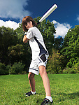 Action portrait of a ten year old boy with baseball bat practicing the game. Sports and children active lifestyle.