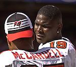 Tampa Bay Buccaneers wide receiver Keyshawn Johnson (19) talks to  Keenan McCardell (87) on Sunday, October 19, 2003, in San Francisco, California. The 49ers defeated the Buccaneers 24-7.