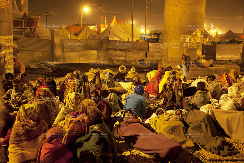India. Uttar Pradesh state. Allahabad. Maha Kumbh Mela. Indian Hindu devotee families sleep at night on the ground under a bridge. The Kumbh Mela, believed to be the largest religious gathering is held every 12 years on the banks of the 'Sangam'- the confluence of the holy rivers Ganga, Yamuna and the mythical Saraswati. The Maha (great) Kumbh Mela, which comes after 12 Purna Kumbh Mela, or 144 years, is always held at Allahabad. Uttar Pradesh (abbreviated U.P.) is a state located in northern India. 8.02.13 © 2013 Didier Ruef