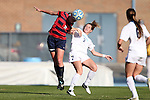 16 November 2013: Liberty's Maddie Boone (2) heads the ball away from North Carolina's Kealia Ohai (7). The University of North Carolina Tar Heels hosted the Liberty University Flames at Fetzer Field in Chapel Hill, NC in a 2013 NCAA Division I Women's Soccer Tournament First Round match. North Carolina won the game 4-0.