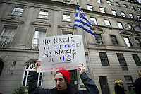 Supporters of democracy in Greece protest against the rise of the Golden Dawn political party in front of the Greek Consulate in New York on Saturday, January 19, 2013.  The Golden Dawn is allegedly a neo-Nazi party rising in popularity in Greece during their economic crisis.   ( © Frances M. Roberts)