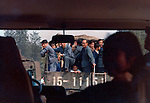 People traveling in back of open truck.Pictures taken in Canton China in 1977 at the time of the cultural revolution.