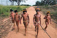 Xingu Indian boys with spears and bows and arrows for hunting and fishing, Amazon Basin, Brazil.