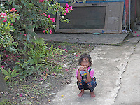 This captivating young princess of Yap Islands, enjoying her mango, was my companion while the rest of the entourage was souvenir hunting...