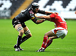 Ryan Jones gets hold of Matt Powell. Ospreys V Worcester Warriors, EDF Energy Cup  © Ian Cook IJC Photography iancook@ijcphotography.co.uk www.ijcphotography.co.uk