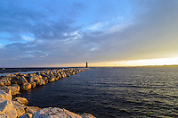 A colorful evening at the Manistique Lighthouse with a warm sun beginning to set. Manistique, MI