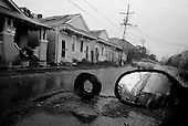 New Orleans, Louisiana.USA.July 27, 2006..A tire marks a hole in the street of a district that was flooded nearly one year after hurricane Katrina hit and the levees broke leaving 80% of the city flooded.