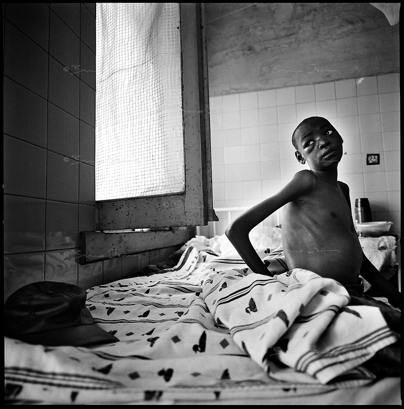 Huambo, Angola, May, 24, 2006.Rufinu Cizongemba, 15, suffers from accute TB; he wants to finish high school and become a math teacher. More than 300 TB patients live in Huambo State Sanatorium, hundreds more are outside patients. TB is endemic in the region, fueled by poverty, malnutrition, inadequate hygiene and the rapid spreading of HIV/AIDS since the end of the civil war in 2002.