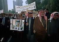 (February 1998)   Pro-Saddam protesters march in the streets of Baghdad, as tensions were high over Un weapons inspections and sanctions. <br /> <br />  The UNSCOM weapons inspectors left Iraq later that year.<br /> <br /> <br /> <br /> &copy;Fredrik Naumann/Felix Features