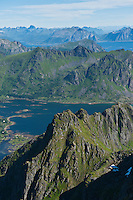View from summit of Justadtind over rugged mountain landscape, Lofoten islands, Norway